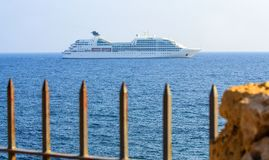 Big cruise liner in the open sea at sunny day. Royalty Free Stock Photography