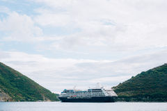 Big cruise ship in the Bay of Kotor in Montenegro. Near the isla. Nd of Our Lady of the Rocks, near Perast. A beautiful country to travel stock photos