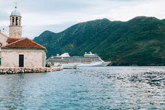 Big cruise ship in the Bay of Kotor in Montenegro. Near the isla. Nd of Our Lady of the Rocks, near Perast. A beautiful country to travel royalty free stock photos
