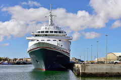 Big cruise ship Boudicca in the port of Luderitz Stock Photo