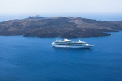 Big cruise ship in the caldera. Santorini island, Greece. View from the Oia village. Wide angle Stock Photography