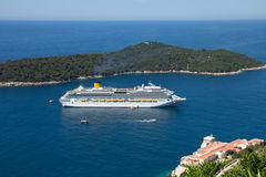 Big cruise ship and island in the sea Royalty Free Stock Images