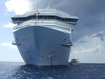 Big Cruise Ship & little boat Stock Images