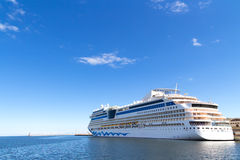 Big cruise ship. Big long travel cruise ship - blue sky and water Royalty Free Stock Photography