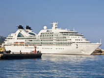 Big cruise ship in port. Yalta, Crimea, Ukraine - May 22, 2012: big white cruise ship leaves port in town Yalta on Black sea Royalty Free Stock Image