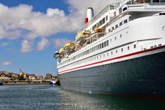 Big cruise ship in the port of Luderitz in the early morning Stock Photo