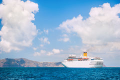 Big cruise ship at the sea near the islands. Royalty Free Stock Image
