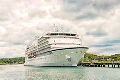 Big cruise ship, white luxury yacht in sea port, Antigua. Big cruise ship, beautiful white yacht, luxury modern motor vehicle at moorage in caribbean sea port stock photo