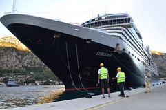 Big cruiser docking in the port of Kotor Royalty Free Stock Images