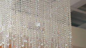Big crystal chandelier on fashion ceiling stock video