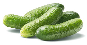 Big cucumber group on white. Background as package design element stock photo
