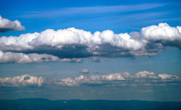 Big cumulus clouds over the land Royalty Free Stock Photo