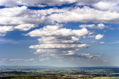 Big cumulus clouds over the land Stock Photography