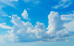 Big Cumulus Fluffy Cloud in Bright Sunlight Stock Photos