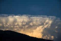 Big cumulus storm cloud. Huge towering cumulus storm cloud in the sky Royalty Free Stock Photo