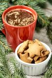 Big cup of coffee. Gingerbread Cookie. NewYear. Spruce branch. Blurred background stock image