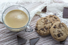 Big cup of espresso with tasty cookies with dark chocolate Stock Images