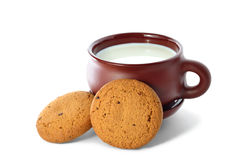 Big cup of milk and cookies. Big earthenware mug of milk and two cookies Royalty Free Stock Photos