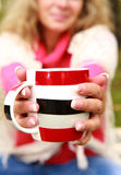 Big cup of tea in woman  hands Royalty Free Stock Photos
