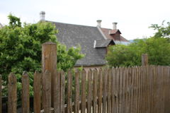 Big custom made luxury house behind the wooden fence. Selective focus Stock Photography