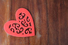 Big cut out heart on old wood background Royalty Free Stock Image