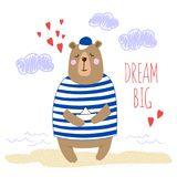 Big cute cartoon bear with paper boat in his paws. Hand-written inscription Dream Big. Stock Photo