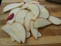 Big cutted apple pieces on wooden background Royalty Free Stock Images