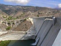 Big Dam & Modern Highway In The Wilderness Stock Photos