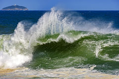 Big, dangerous waves during tropical storm. In the green and blue waters of Rio de Janeiro, Brazil stock photo