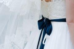 Big, dark blue bow, on bride corsage stock photo