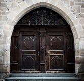 Big dark brown wooden door Royalty Free Stock Images
