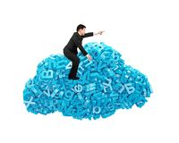 Big data. Blue characters in cloud shape with businessman riding. Big data and cloud computing concept. Businessman riding on cloud of blue letters and numbers stock photography
