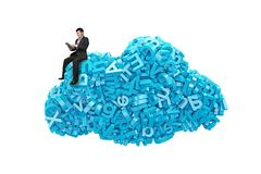 Big data. Blue characters in cloud shape with businessman sitting. Big data and cloud computing concept. Sitting businessman using digital tablet on cloud of stock image