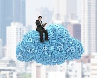 Big data. Blue characters in cloud shape with businessman sitting stock photography