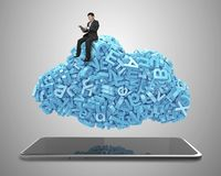 Big data. blue characters cloud shape. Smart tablet. Businessman sitting stock photos