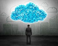 Big data. Businessman facing blue characters in cloud shape royalty free stock photos