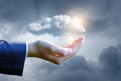Big data cloud in the hand . The concept of control over data stock photo