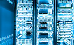 Big data dark server room with bright equipment Royalty Free Stock Images