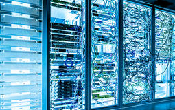 Big data dark server room with bright equipment Stock Photography