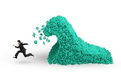 Big data. a huge characters tsunami wave with businessman running. Big data concept. Businessman running with a tsunami wave of computer data, huge amount of stock images