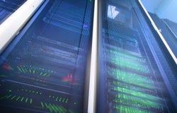 Big data and information technology concept. Supercomputer data center. Multiple exposure. Server room in data center full of tele Stock Image