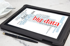 Big data. Tablet with big data word cloud Stock Photography