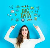 Big Data with young woman looking upwards. Big Data with young woman reaching and looking upwards Stock Photography