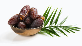 Big date fruits. Dried date palm tree fruits and green leaf isolated on white Royalty Free Stock Photos