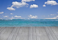Big deck going out to tropical beach Royalty Free Stock Photography