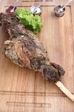 Big delicious baked leg of lamb. royalty free stock photos