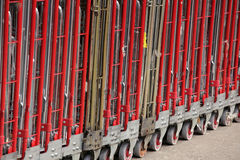Big delivery trolleys. Outside supermarket in Brixton in London Stock Image