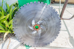 Big diamond blade for cutting thick concrete. At construction site Royalty Free Stock Image
