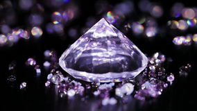 Big diamond with many violet small one rotating. Over dark background stock footage