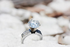 Big Diamond Ring. On a stone background Royalty Free Stock Image